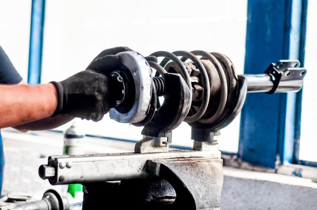shock-absorber-being-adjusted-in-a-car-workshop